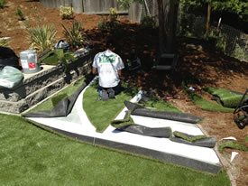 Prior to the artificial grass installation with all the pieces not put together.